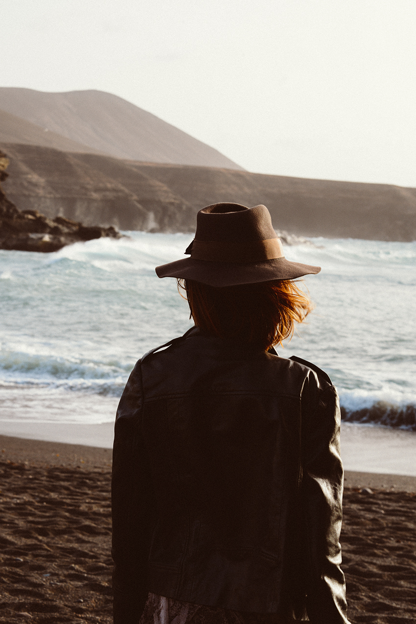the petticoat beach portugal hat black jacket  back